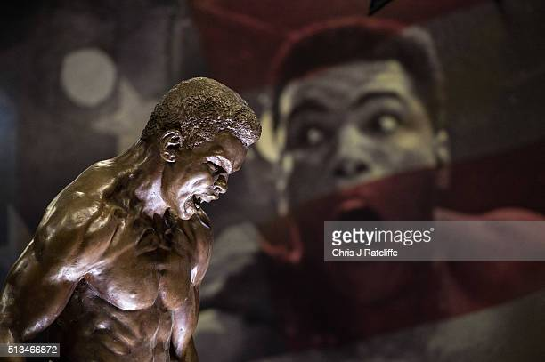 A statue of Muhammad Ali on display in front of posters at the preview of the 'I Am The Greatest' Muhammad Ali exhibition on March 3 2016 in London...