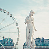 Statue of naked lady and carrousel in back