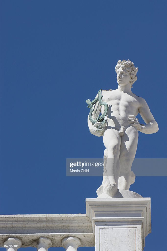statue of naked man with harp : Stock Photo