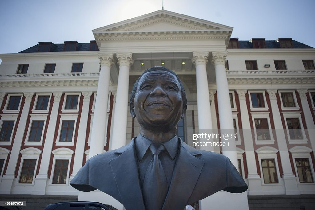 A statue of Nelson Mandela South Africa's first democratic president and Nobel Laureate is pictured outside the parliament where South African...