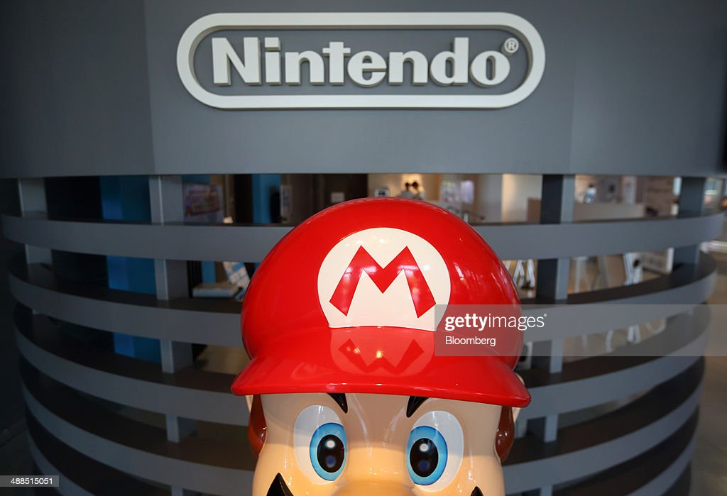 A statue of Nintendo Co.'s video-game character Mario stands at the company's showroom in Tokyo, Japan, on Wednesday, May 7, 2014. Nintendo, the world's largest maker of video-game machines, reports its full-year earnings today. Photographer: Tomohiro Ohsumi/Bloomberg via Getty Images