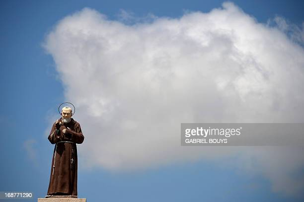 A statue of Padre Pio is seen near Ostuni in the Puglia region SouthEast of Italy on May 12 2013 Padre Pio who became famous for bearing the stigmata...
