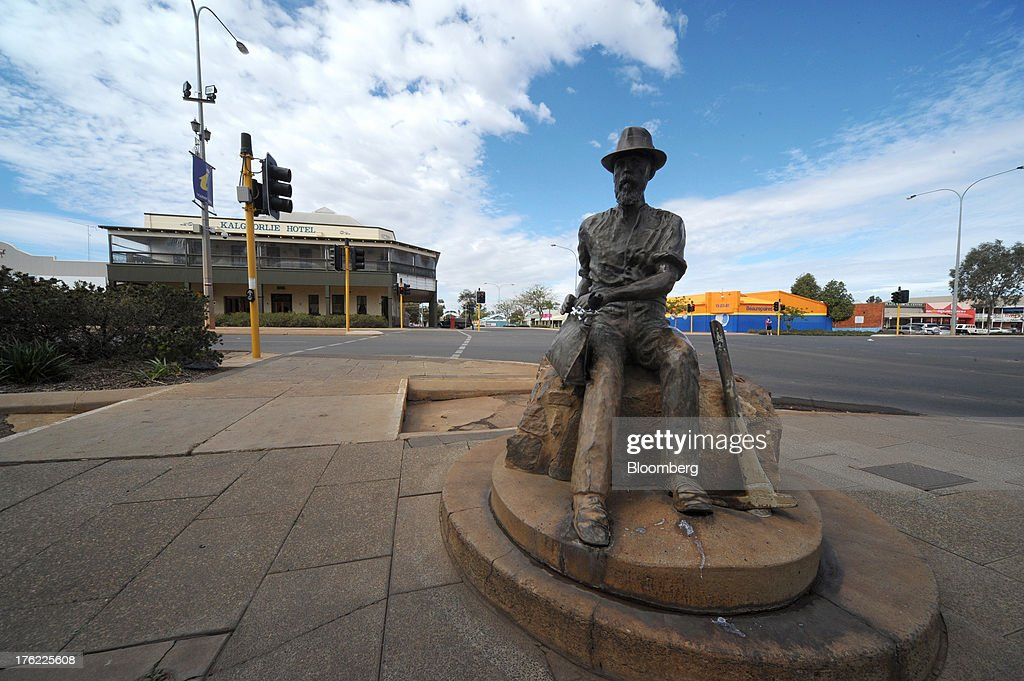 A statue of Patrick 'Paddy' Hannan, the first man to find gold in Kalgoorlie, sits at the top of Hannan Street in the mining town of Kalgoorlie, Australia, on Thursday, Aug. 8, 2013. Western Australia, the nation's largest state by area with 2.6 million square kilometers (1 million square miles) of land, earned A$97 billion from minerals and energy sales in 2012, down from A$108 billion in 2011, according to government figures. Photographer: Carla Gottgens/Bloomberg via Getty Images