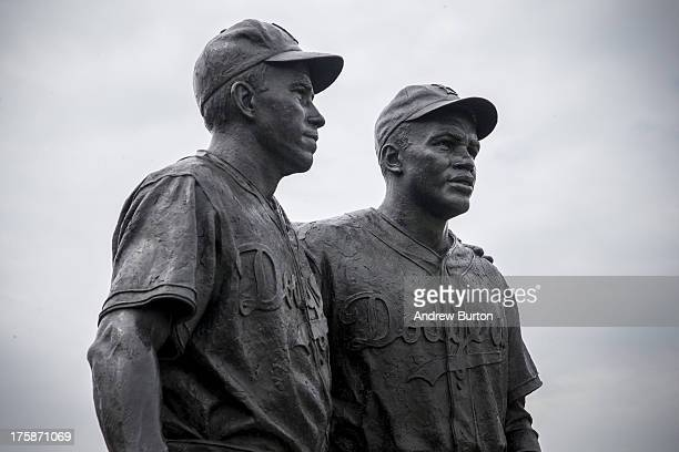 A statue of Pee Wee Reese and Jackie Robinson stands after being cleaned of racist graffiti on August 9 2013 in the Coney Island neighborhood of the...