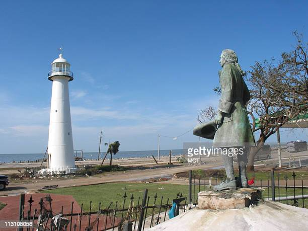 LONG BEACH MS A statue of Pierre LeMoyne Sieur D'Iberville looks over the lighthouse in Biloxi Mississippi on Tuesday August 30 2005 The lighthouse...