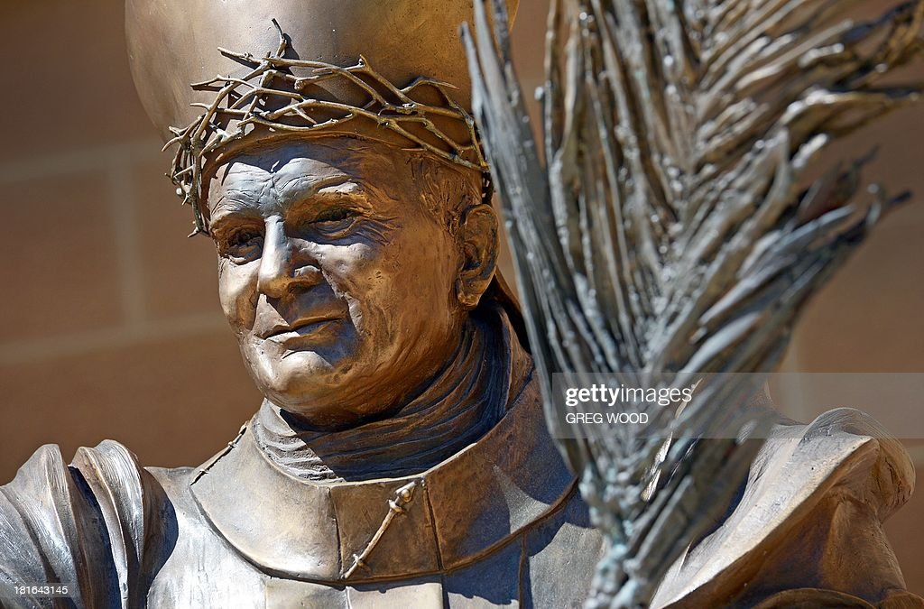 A statue of Pope John Paul the Great by sculptor Fiorenzo Bacci and donated in the year of the 23rd World Youth Day on April 19, 2008 stands outside Saint Mary's Cathedral in Sydney on September 23, 2013. AFP PHOTO / Greg WOOD CAPTION
