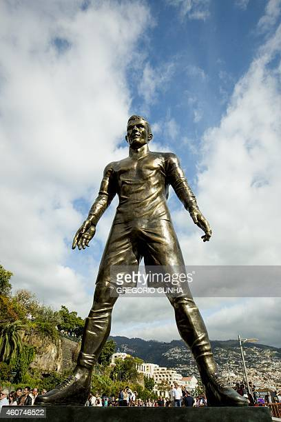 A statue of Portuguese national team football player Cristiano Ronaldo and Real Madrid player is pictured during the unveling ceremony in his...