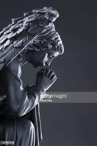 Statue of praying angel, b&w