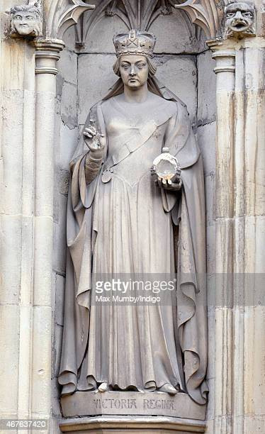 A statue of Queen Victoria by the Great West Door of Canterbury Cathedral on March 26 2015 in Canterbury England