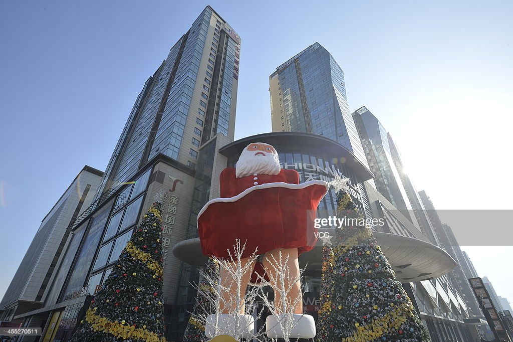 A statue of Santa Claus imitating Marilyn Monroe's famous pose stands in front of a shopping mall on December 11, 2013 in Taiyuan, China. This idea is copied from Marilyn Monroe's film 'The Seven Year Itch'.