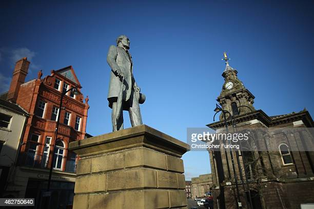 A statue of Sir Henry Doulton founder of Royal Doulton China overlooks Burslem on February 4 2015 in Burslem StokeonTrent United Kingdom The North...
