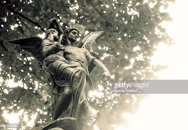 Statue of St Michael, Pere Lachaise Cemetery, Paris, France, Europe