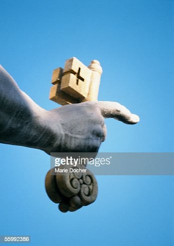 Statue of St. Peter, hand holding key, close-up