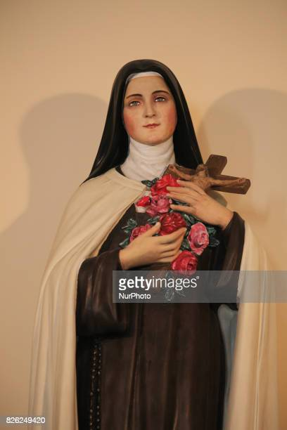 Statue of Ste Therese de l'Enfant Jesus in the Catholic Cathedral of Saint John the Baptist in the village of Fira on Santorini Island Greece