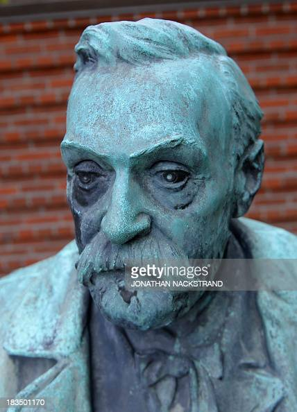 A statue of Swedish inventor of dynamite Alfred Nobel is seen prior to a press conference to announce the laureate of the 2013 Nobel Prize in...