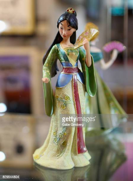 A statue of the character Mulan from the animated movie 'Mulan' is displayed during a preview event at the Magical Memories Fine Art Gallery inside...