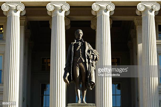 A statue of the first Secretary of the Treasury Alexander Hamilton stands in front of the US Treasury Department building March 23 2009 in Washington...