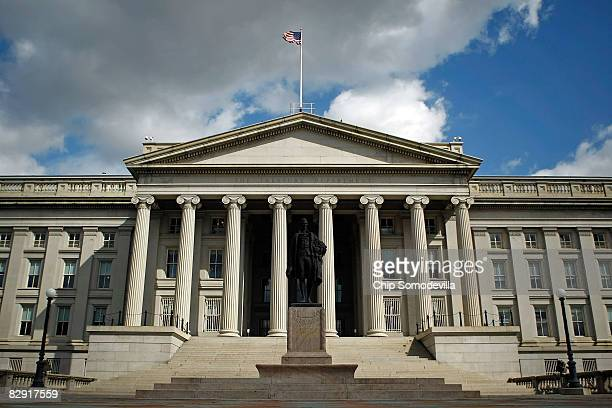 A statue of the first United States Secretary of the Treasury Alexander Hamilton stands in front of the US Treasury September 19 2008 in Washington...