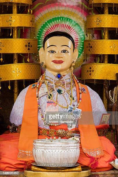 Statue of the genie Preah Chau in shrine on Wat Phnom hill.
