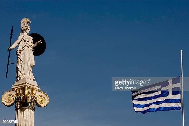 A statue of the Goddess Athena stands outside the Athens Academy one of the city's modern landmarks on May 11 2010 in central Athens The Academy is...