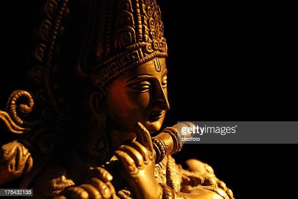Statue of the Hindu God Krishna playing a flute