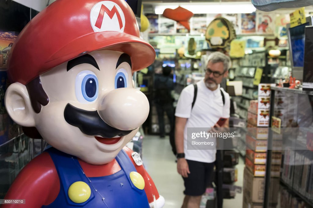 A statue of the Nintendo Co. video-game character Mario stands on display at the Super Potato video game store in the Akihabara district of Tokyo, Japan, on Tuesday, Aug. 8, 2017. Renewed interest in vintage Japanese videogamesis drawing buyers to the country'sonline markets and retro gaming shops. Photographer: Tomohiro Ohsumi/Bloomberg via Getty Images