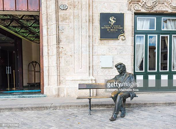 Statue of the pianist and composer Frederic Chopin sitting Black color metal statue in front of hotelmallpalace fixed on a bench Cubans are famous...