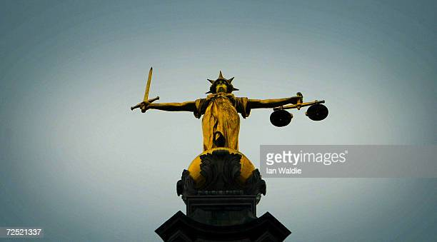 A statue of the scales of justice stands high above the Old Bailey on December 12 2003 in London Ian Huntley is accused of murdering youngsters...