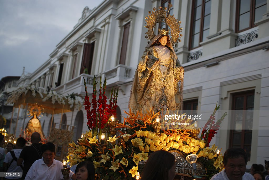 A statue of the Virgin Mary is paraded on a float during the Grand Marian Procession celebrating the immaculate conception of the Virgin Mary in Intramuros on December 2, 2012 in Manila, Philippines. Devout Catholics gather in Intramuros to view the ninety statues of the Virgin Mary from different parts of the Philippines being carried through the streets of the walled city of Intramuros. The annual event attracts thousands of devotees and is a mix of rich Catholic tradition along with Filipinos' penchant for year-round festivities.