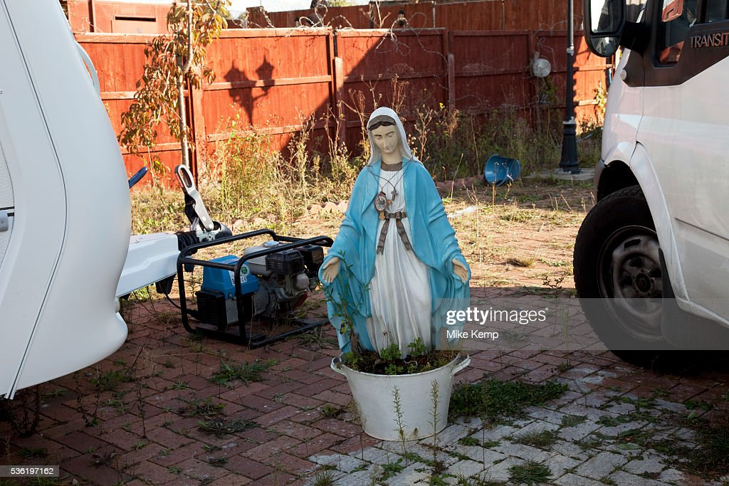 Statue of the Virgin Mary on the site Protesters who barricaded themselves above the entrance to the Dale Farm travellers' site have been removed by...