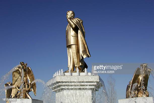 A statue of Turkmenistan's former President Saparmurad Niyazov near the statue of Liberty 13 February 2007 in Ashgabat AFP PHOTO / MUSTAFA OZER