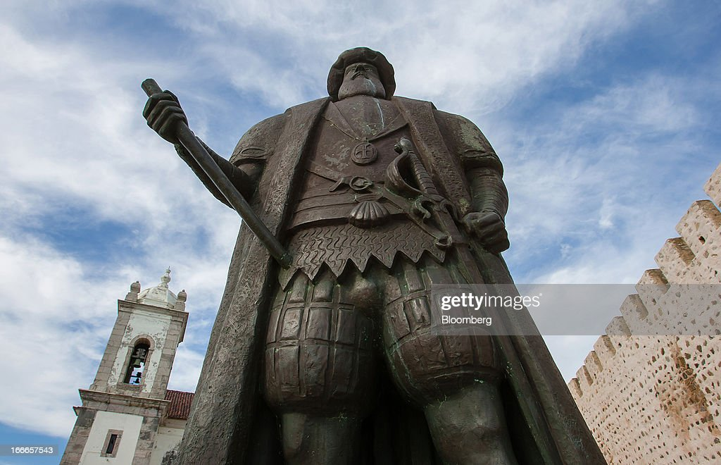 A statue of Vasco da Gama, Portuguese explorer, stands overlooking the Atlantic ocean and port in Sines, Portugal, on Friday, April 12, 2013. Portugal's government plans to cut about 1.2 billion euros ($1.6 billion) in spending this year after the country's highest court blocked a plan to suspend the equivalent of a monthly salary payment to state workers and pensioners. Photographer: Mario Proenca/Bloomberg via Getty Images