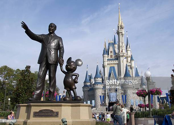 A statue of Walt Disney and Mickey Mouse stands in front of the Cinderella's castle at Walt Disney World's Magic Kingdom in Lake Buena Vista Florida...