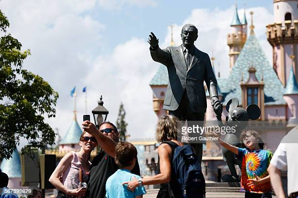 ANAHEIM CA MAY 20 2014 A statue of Walt Disney rises above patrons walking along Main Street in Disneyland Tuesday May 20 2014 Disneyland which calls...
