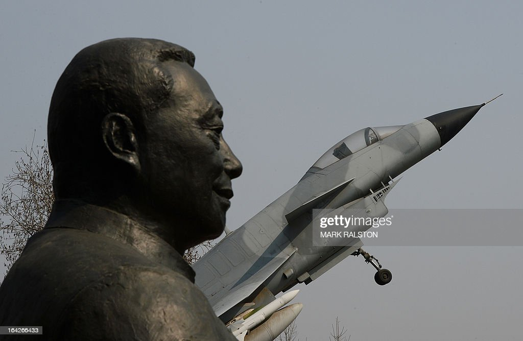 A statue of Wu Daguan who is known as the 'Father of China's military and civilian aviation industry' beside a Chinese produced J-10 fighter jet in Beijing, on March 22, 2013. China has overtaken Britain to become the world's fifth largest arms exporter with five percent of the global trade, its highest position since the Cold War. China's arms exports in 2008-2012 grew by 162 percent compared to the previous five years, due to large orders for combat aircraft, submarines and frigates. AFP PHOTO/Mark RALSTON