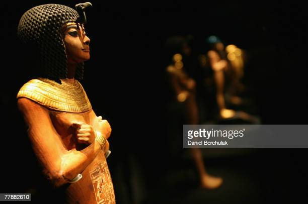 A Statue of young Tutankhamen is pictured during the press viewing of the 'Tutankhamun Exhibition The Golden Age of the Pharaohs' at the O2 Centre on...
