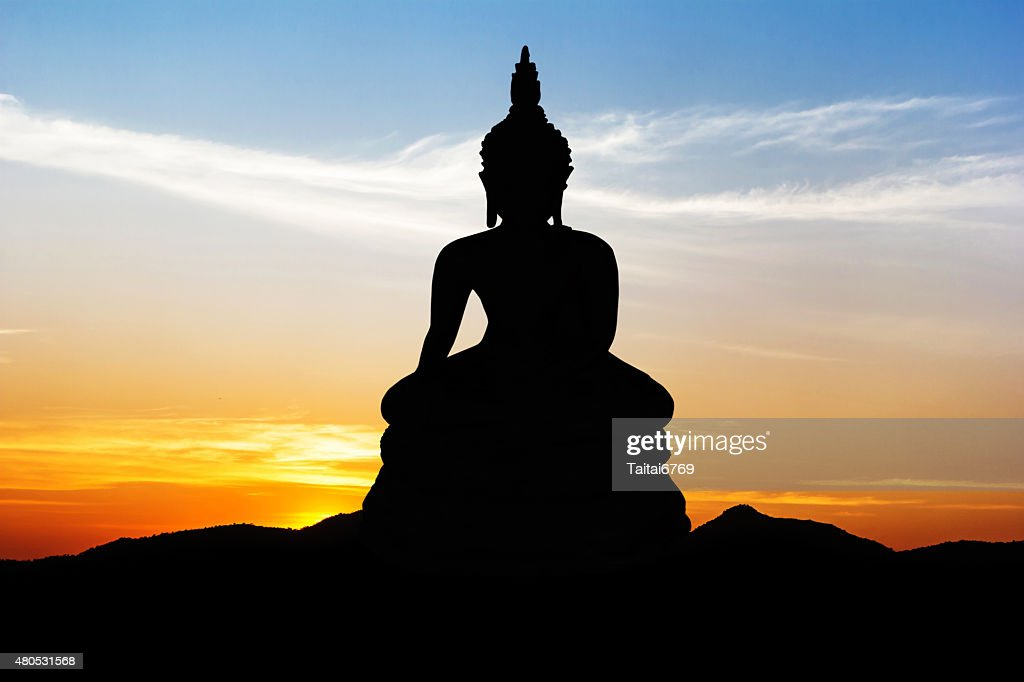 Statue on black mountain : Stock Photo
