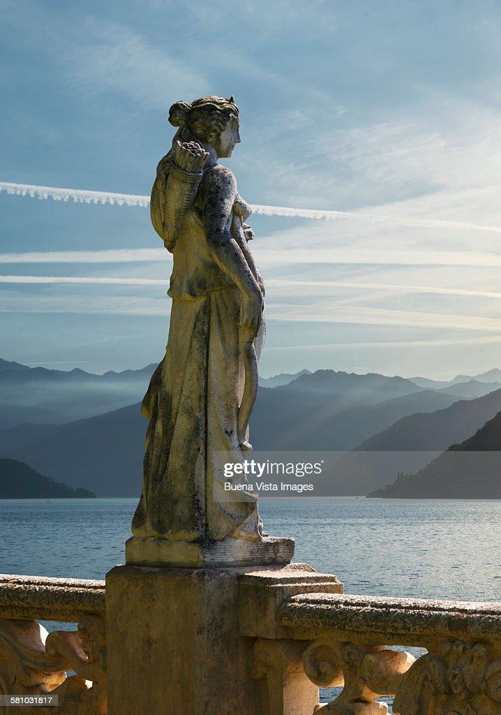 Statue on Lake Como at sunrise