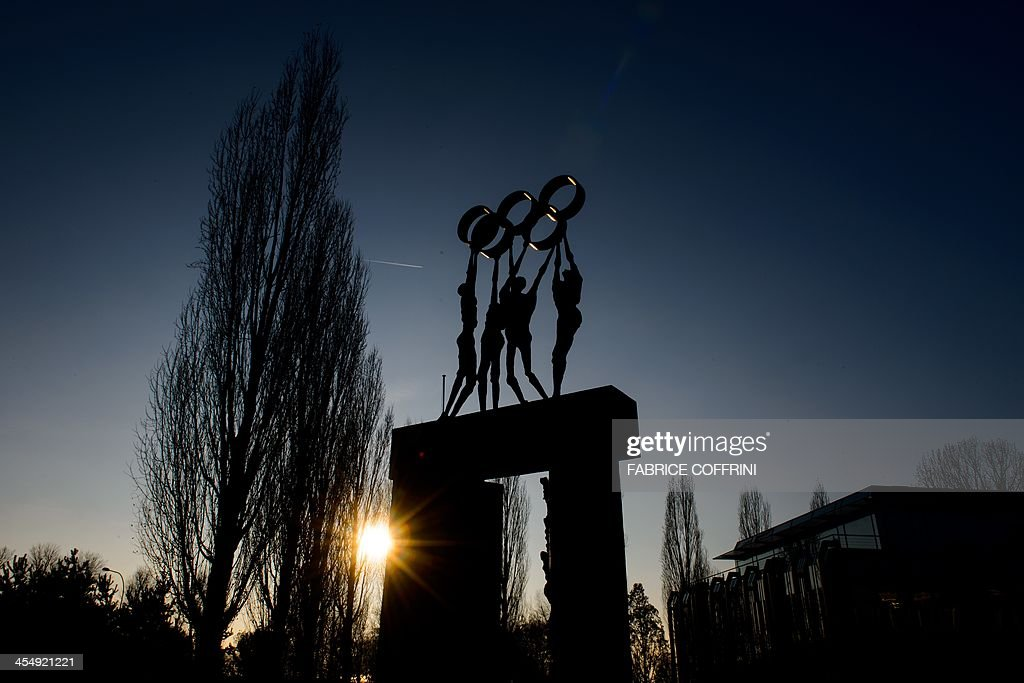 A statue representing people carrying the Olympic Rings is pictured on December 10 2013 at International Olympic Committee headquarters in Lausanne...
