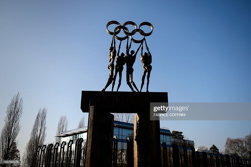 A statue representing people carrying the Olympic Rings is seen on December 10 2013 at International Olympic Committee headquarters in Lausanne AFP...