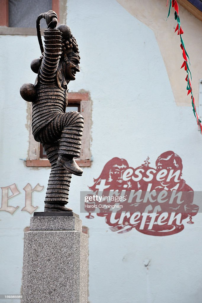 A statue representing the so-called 'Schuttig' prior to the traditional torch parade on January 12, 2013 in Elzach, Germany. The Elzach procession launches the carnival season in southwestern Germany which culminates on Rose Monday. Dating from 1530 the carnival marks a festive period where the bad spirits are expelled prior to the Lenting season.