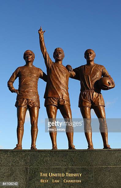 A statue showing George Best Denis Law and Bobby Charlton is seen outside Old Trafford on December 9 2008 in Manchester England