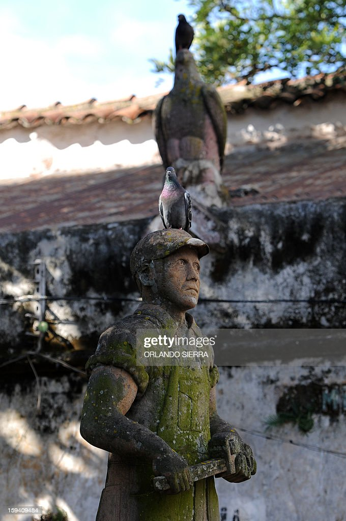 A statue stands at the run-down Central Penitentiary in the historic center of Tegucigalpa on January 13, 2013. The prison, which was built in 1880 and destroyed by hurricane Mitch in 1998, was declared of national interest in 2002. AFP PHOTO /Orlando SIERRA