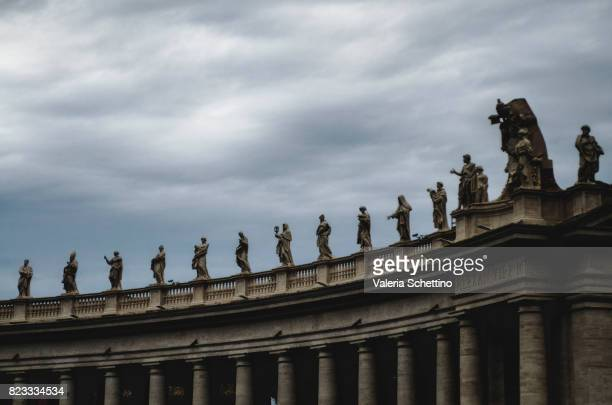 Statues Above Columned Entrance Area To Piazza San Pietro With St Peter's Basilica Behind, Vatican City