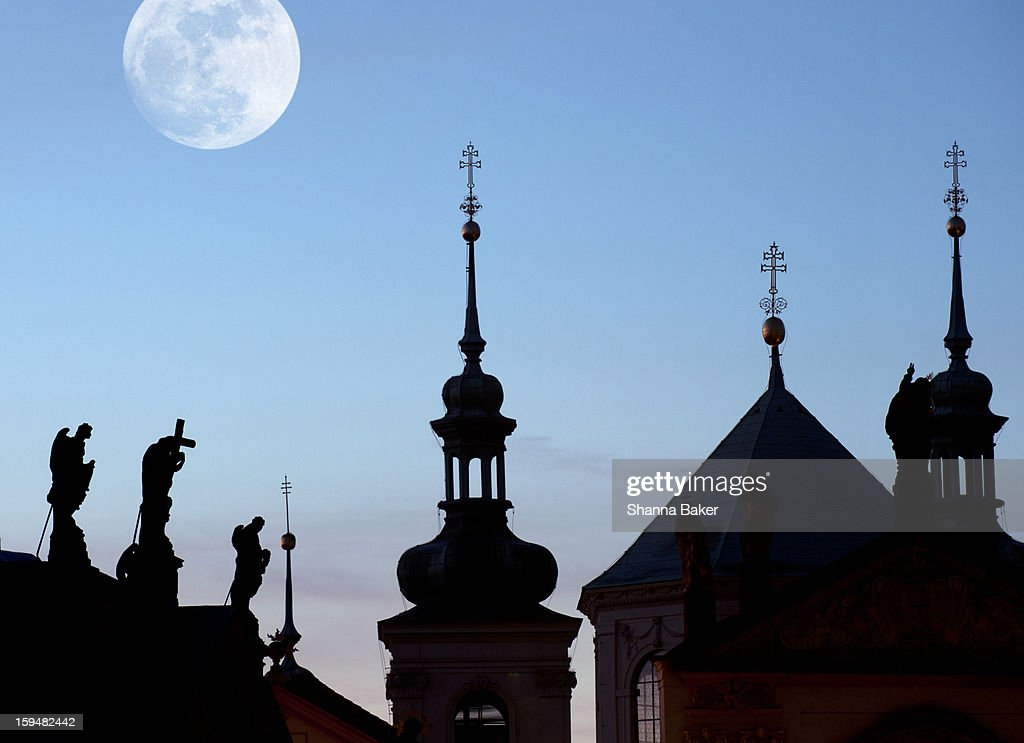 Statues and spires in silhouette, Prague : Stock Photo