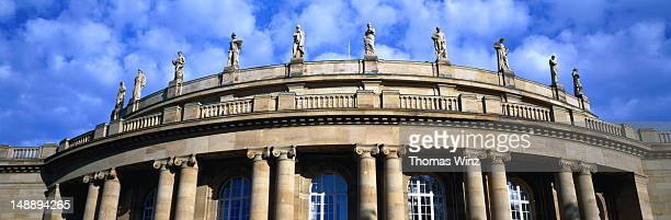 Statues crown the roof of the Stuttgart State Opera building.