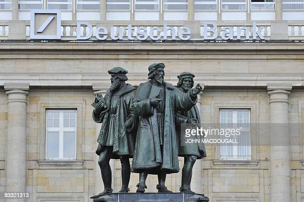 Statues forming the Gutenberg memorial stand in front of a Deutsche Bank building in Frankfurt on October 17 2008 The bundestag the German lower...
