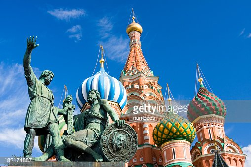 Statues in front of St Basil Cathedral with blue sky