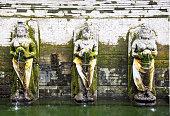 some statues inside Goa Gajah Temple Bali Indonesia