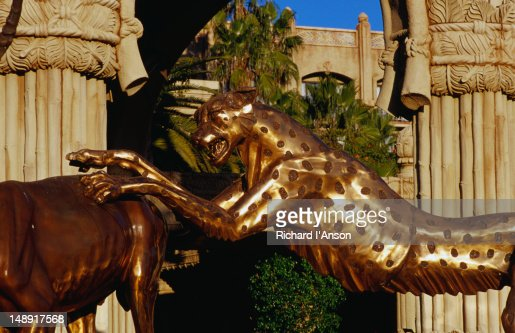 Statues of animals, a leopard pouncing on an antelope at the entrance to the Palace of the Lost City Hotel